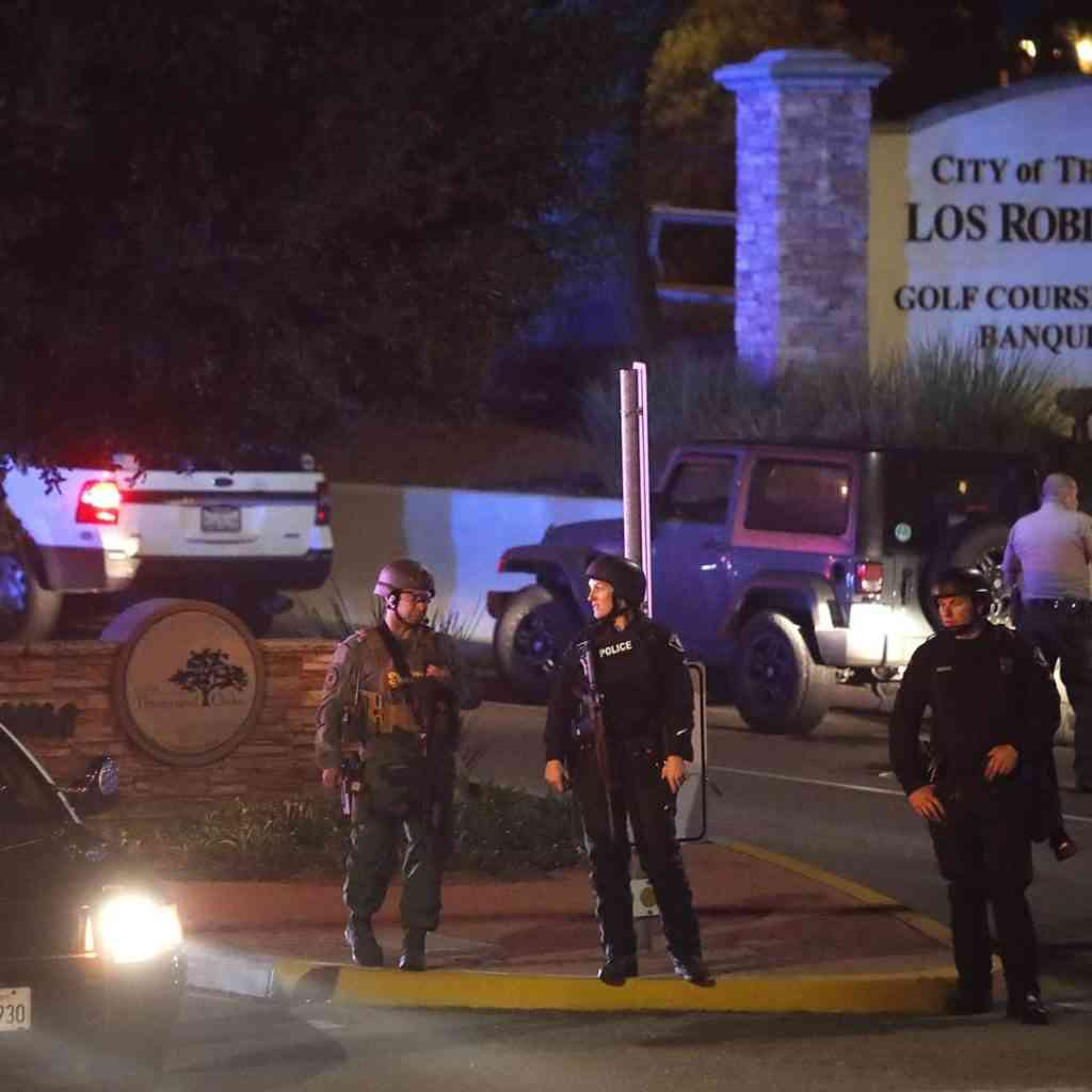 Law enforcement officers standing in the street of the active shooting location of Borderline Bar & Grille in California on the night of 11/7/2018